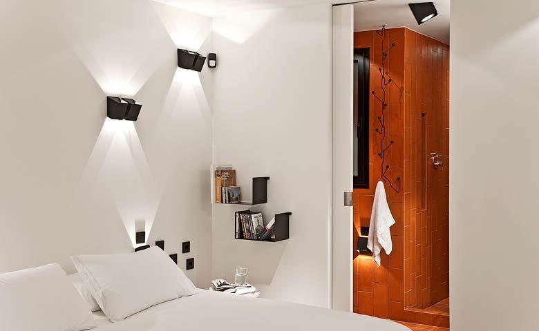 Urgell Apartment — Sleeping area and bathroom