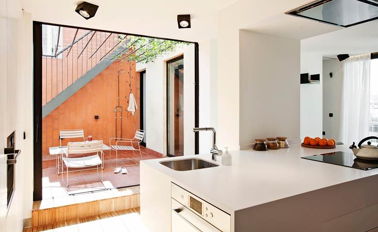 Urgell Apartment — Kitchen and terrace
