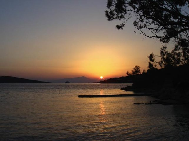 Greek Island Retreat — Sunset from the villa